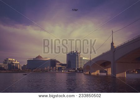 Tempe, Az,USA- 3.24.18:  Historic Mill Avenue Bridge. Built in 1931,gateway to the Mill Avenue District and Tempe Town Marina.  Stunning colorful Arizona sunset over waterfront office buildings.