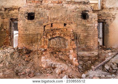 Stone Wall Texture And Broken Oven. Broken Brick Building Background Pattern
