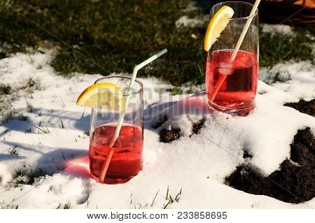 Two Same Drinks In Snow For Design And Drinking. Garden Party