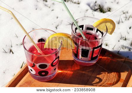 A Small Glass With Ornaments. In Cups There Is Juice With Vodka And Straw. All It Is On Wooden Board