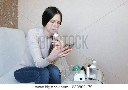 Use Nebulizer And Inhaler For The Treatment. Young Woman Inhaling Through Inhaler Mask And Looking A