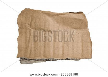 Brown Corrugated Texture Paper Torn On White Background. Rip Of Cardboard Sheet Used As A Background