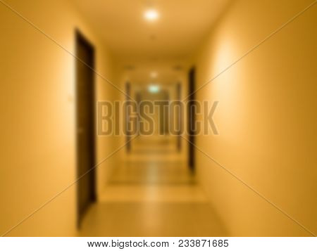 Blurred Long Corridor In Building With Doors. Medical, Hospital, Office, Hotel.