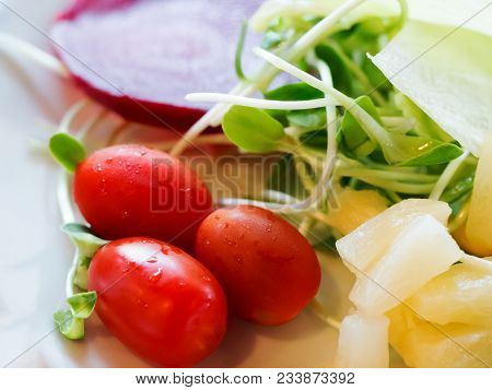 Fresh Red Tomatoes With Green Vegetable And Beetroot, Pineapple In White Plate For Salad Meal. Clean