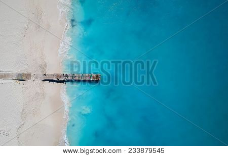 Drone Photo Of Pier In Grace Bay, Providenciales, Turks And Caicos. The Caribbean Blue Sea And White
