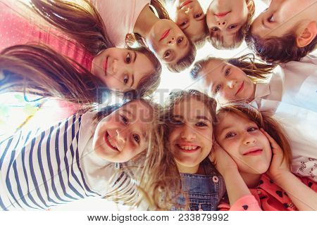 Bottom View Of Young Girl Faces In The Round. Schoolmates On The Break