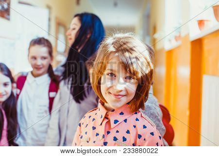 A Good Girl Smiles And Enjoys The Time Spent With Classmates
