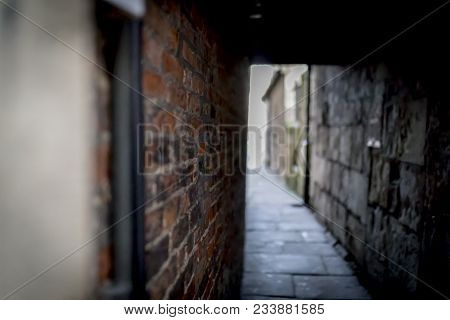 Spooky And Creepy Dark Brick Alley Or Hidden Passage Leading To The Light In The Uk