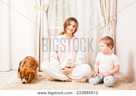 The Girl Is Happy To Spend Her Time For Her Small Brither And Animals