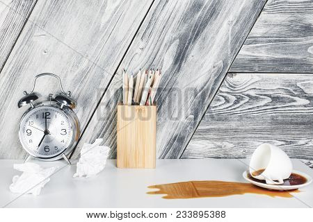 Modern Office Desk With Supplies, Alarm Clock And Spilt Coffee