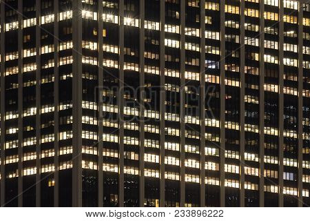 Exterior Of Modern Office Building Windows At Night