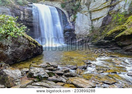 A beautiful wide landscape view of Looking Glass Falls in Asheville, North Carolina.