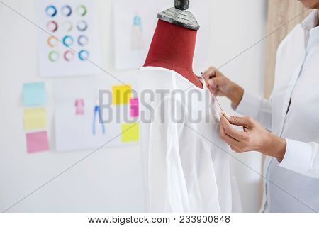 Young Woman Dressmaker Or Designer Working As Fashion Designers Measure And Repairing Clothes And Se