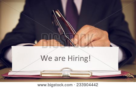 We Are Hiring A Sign As A Concept And Employer Hiring Staff To Work For A Company.