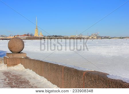 St. Petersburg Cityscape View From Granite Neva River Embankment And Peter And Paul Fortress On Back