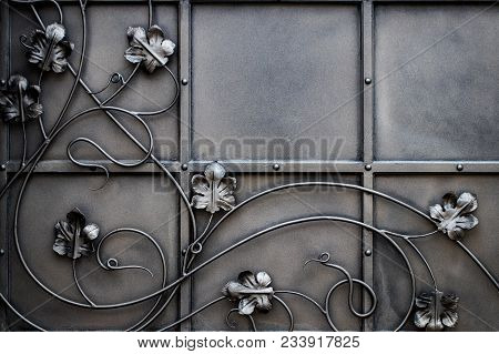 Details, Structure And Ornaments Of Forged Iron Gate. Floral Decorative Ornament, Made From Metal. V