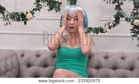 Young Sad Woman In Wig With Headache Massaging Her Temples With Circular Motion, Healthcare And Stre