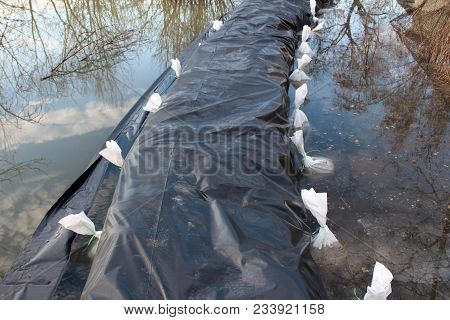 Sandbags Flood Protection Covered With Black Nylon And Surrounded With New Sandbags Completely Flood