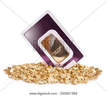 Gold Bullion On Heap Of Golden Nuggets