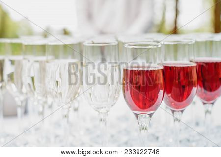 Glass Of Red And White Wine On A Table. Many Glass Wine In A Row On White Tablecloth. Glasses With W