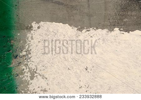 Green, White Paint On Grunge, Concrete Wall. Abstract, Textures, Background. Close Up Of Rough, Weat