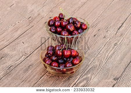 Berries Of A Sweet Cherry In A Glass Bowl On A Wooden Background. Ripe Red Sweet Cherry.