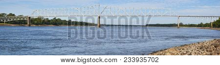 A Panoramic Picture Of A Long Bridge Reaching Across Mississippi River