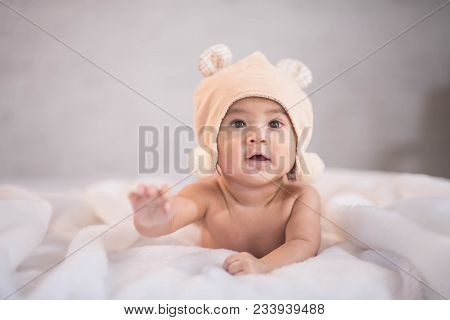 Close Up Of Portrait Asia Baby On White Bed