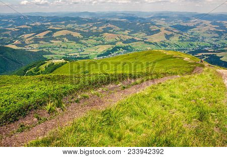 Foot Path Down The Grassy Hillside. Location Mountain Gymba, Transcarpathia, Ukraine. Tourists Climb