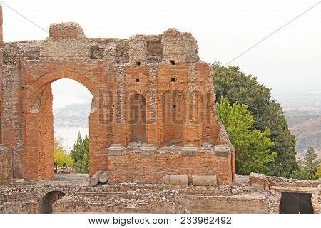 Greek Theater In The City Of Taormina, Sicily Island, Italy. Old And Ancient Stone Ruins. Old Greek