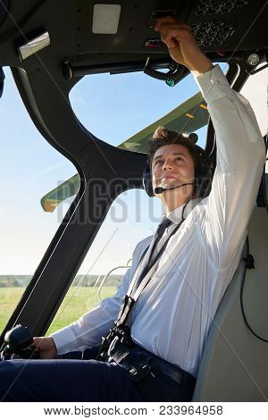 Pilot In Cockpit Of Helicopter Before Take Off