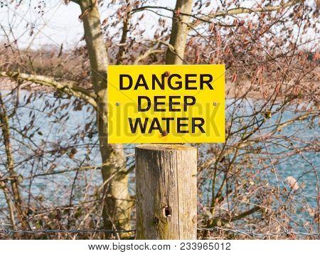 Yellow And Black Sign Danger Deep Water Lake