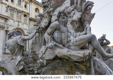 Rome, Italy Fontana Dei Quattro Fiumi At Piazza Navona. Day View Of 17th-century Fiumi Fountain At N