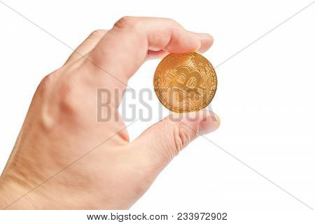 Crypto Currency In The Form Of A Symbolic Gold Coin In The Hand