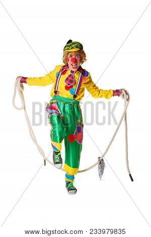 Funny Clown Jumps On A Skipping Rope Isolated On White