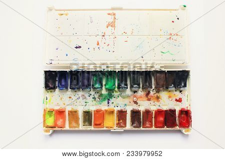 Watercolor Paint Palette Isolated On White Background. Colorful Used Open Palette, Art Studio Instru