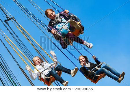 Teens on the chain swing carousel