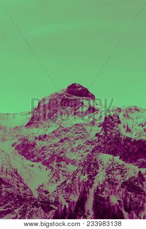 Photo depicting a beautiful moody frosty landscape. Colorful European alpine mountains with snow peaks on a sky background. poster