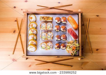 Sushi Set Nigiri And Sushi Rolls And On Wooden Serving Board