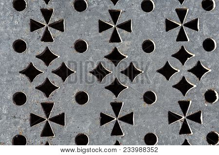 Pattern In The Form Of Crosses Of Diamonds And Circles Embossed On Metal