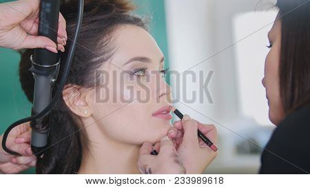 Make Up Artist Doing Professional Make-up Lips For Attractive Young Mode, Close Up