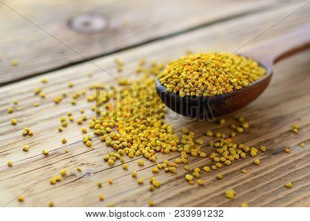 Bee Pollen In Spoon Over Wooden Background. Healthy Organic Raw Diet Vegetarian Food Ingredient - Be