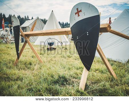Outdoor Scene Of Medieval Way Of Life. Red Black Knights Shield With Family Coat Of Arms Fixed On Th