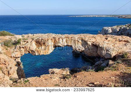 Natural Stone Bridge Cave In The Mediterranean Sea, In Ayia Napa, Cyprus.