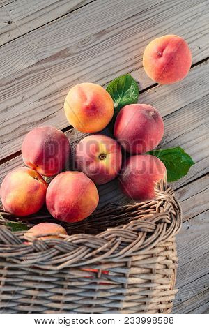 Fresh Peaches Fruits With Leaves  On Wooden Rustic Background.