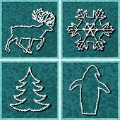 Four editable vector designs of frosty winter symbols as separate elements from background poster