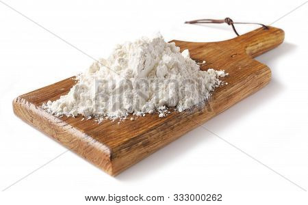 Heap Of Flour On Wooden Cutting Board Isolated On White Background