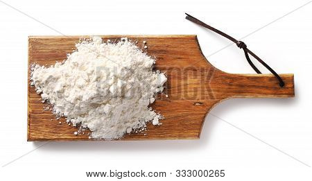 Heap Of Flour On Wooden Cutting Board Isolated On White Background, Top View