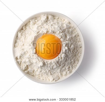 Bowl Of Flour And Egg Yolk Isolated On White Background, Top View