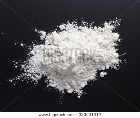 Heap Of Flour On Black Background, Top View